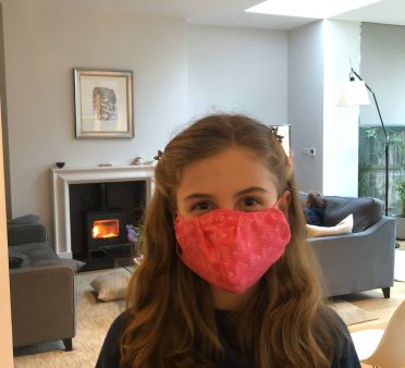Year 6 Falcons pupil wearing homemade mask
