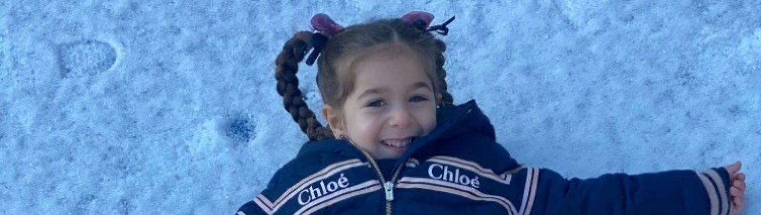girl making a snow angel