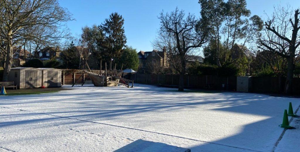 snow across a school playground