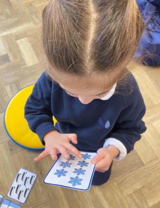 Girl playing maths game