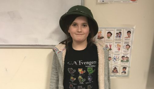 Girl wearing army hat