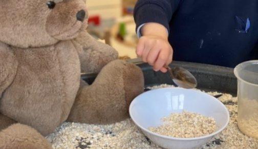 Nursery Boy Engaging In Oat Play