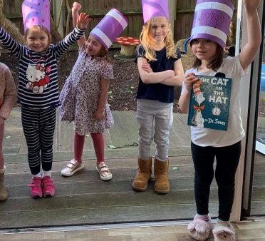 Reception girls wearing hats