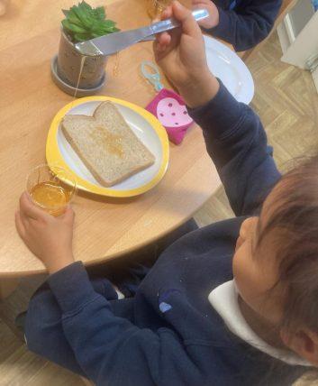 pupil making honey sandwich