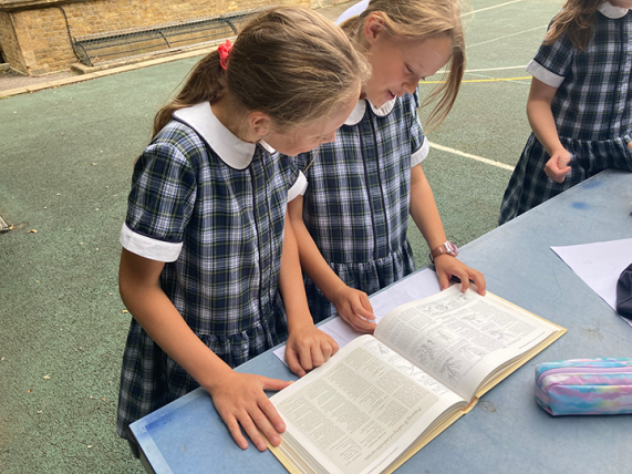 Life Skills - Two pupils reading a gardening book
