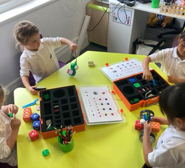 Young pupils doing robotics